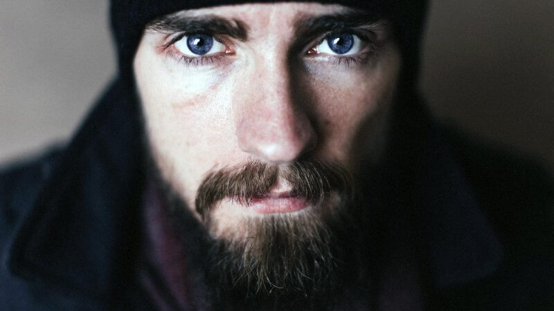 Bearded Man Looking Directly Into Camera Good Skin Care